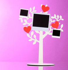 Holder in form of tree with instant photo cards