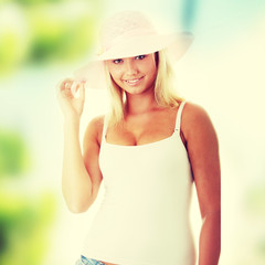 Young woman wearing a pink straw hat