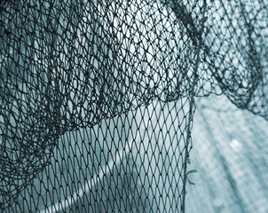 Old fishing net blue background. Photo with shallow DOF