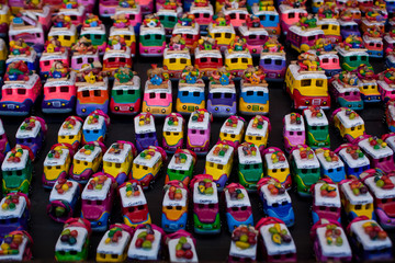 Bus figurines for sale at Chichicastenango market Guatemala