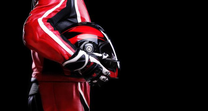 closeup of biker holding helmet side view