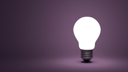 Glowing light bulb on violet