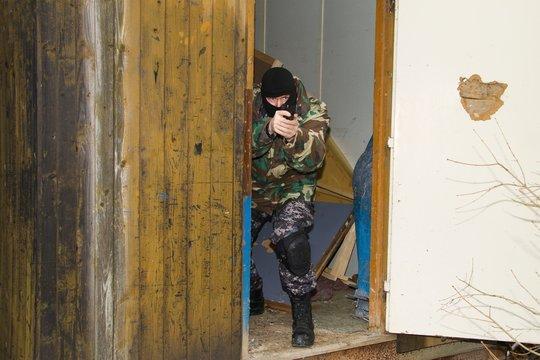 masked gunman in hiding