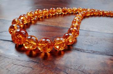 Amber necklace on dark wood