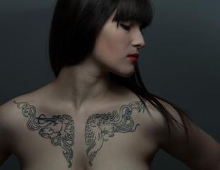 beautiful brunette girl with tattoo