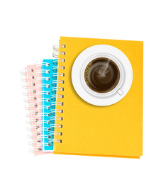 Coffee on stack of ring binder book or notebook isolated on whit