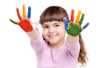 Happy girl with paint on her palms isolated on white
