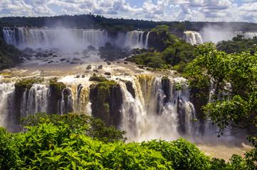 Beautiful cascade of waterfalls. Iguassu falls in Brazil with ri