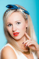 Portrait beautiful blonde woman pinup girl retro style on blue