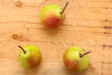 Three pears fruits on wooden table background
