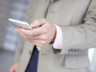 business person using smartphone