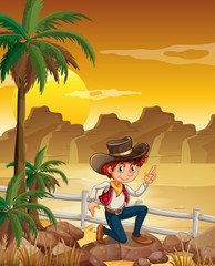 A young cowboy at the desert near the rocks