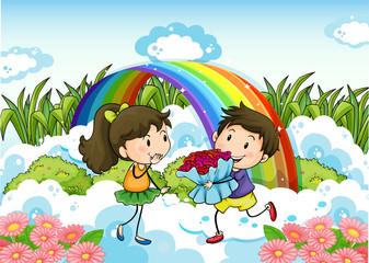 A couple dating near the rainbow