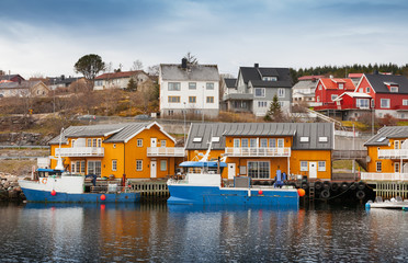 Norwegian fishing village with wooden houses on the coast