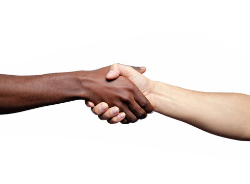 Handshake between african and a caucasian man, isolated on a whi