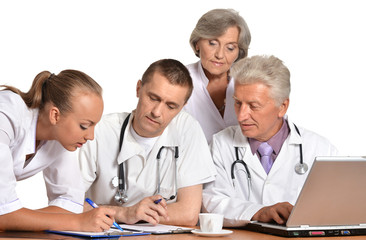 A group of doctors discussing