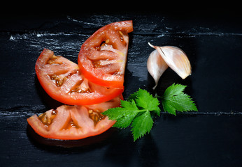 Tomato with Parsley and Garlic Cloves. Healthy and Organic Foods