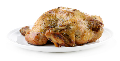Whole roasted chicken on plate, isolated on white
