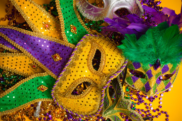 Wall Mural - Colorful group of Mardi Gras or venetian masks on yellow