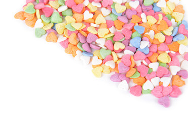 Colorful candy-hearts isolated on white