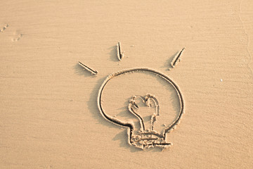 image of a burning bulb in the wet sand