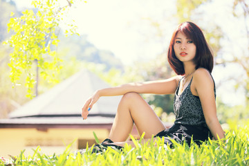 portrait of beautiful young asian woman in the park