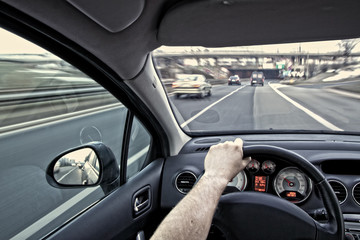 Fototapete - Driving a car on the highway