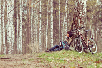 Cyclist rests in a forest