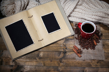 Composition with coffee cup, plaid, and photo album,
