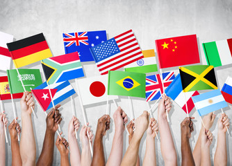 Multi-Ethnic Group of People Holding National Flags