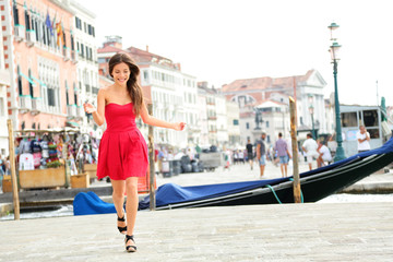 Happy summer girl running in dress, Venice, Italy