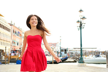 Woman happy running in summer dress, Venice, Italy