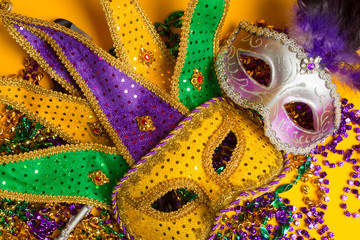 Wall Mural - Colorful group of Mardi Gras or venetian mask on yellow