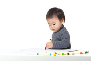 Asia baby boy focus on drawing