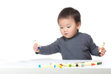 Asia baby boy concentrate on drawing