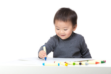 Asian bay boy concentrate on drawing