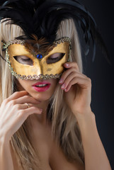 Sexy woman in mysterious venetian carnival mask