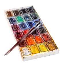 Colourful watercolors and brushes isolated on white