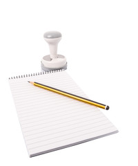 Rubber stamps, pencil and notepad over white background