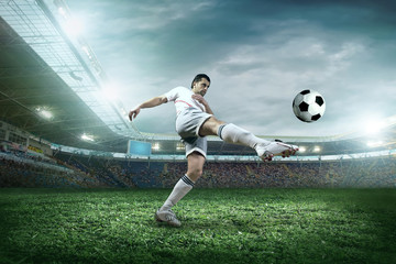 Soccer player with ball in action outdoors.