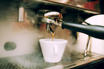 modern coffee and espresso machine pouring coffee