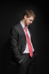 Businessman sitting in a free position, his head bowed.