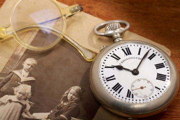 Antique pocket watch and a very old photo