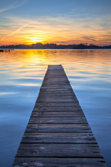 Wall Mural - Picturesque Sunset over Wooden Jetty in Groningen, Netherlands