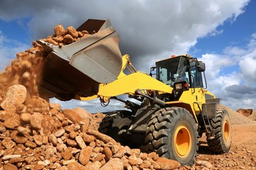 Front End Loader Tipping Stone Wall mural