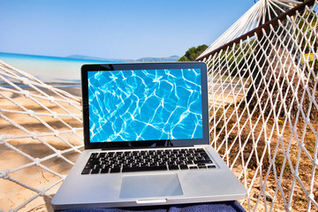 laptop in hammock on the beach