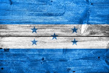 Honduras Flag painted on old wood plank texture