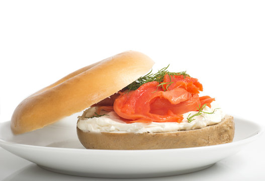 Plain bagel with cream cheese, salmon and dill