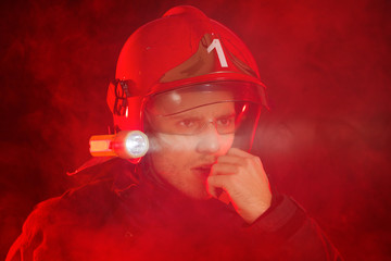 Firefighter in action using walkie-talkie