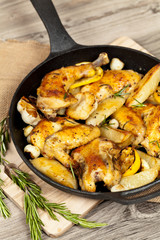 Garlic, Lemon and Rosemary Roasted Chicken on Frying Pan